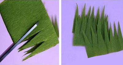 手工制作纸花朵4,花托的制作,如图用剪刀在绿色的纸上剪出小草的图形