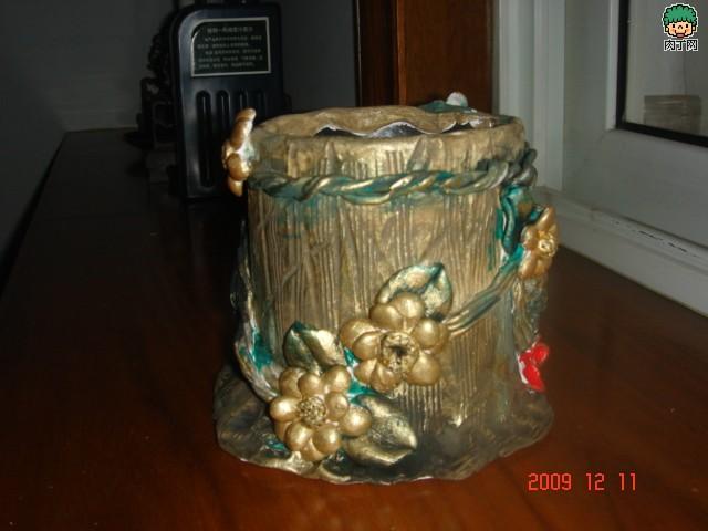 怎么用塑料瓶做笔筒 茶叶桶变创意笔桶-封存